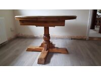 Round extending dining table and chairs