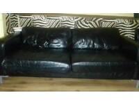 Black leather sofa ..