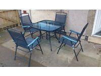 Garden table and four chairs + umbrella for sale.