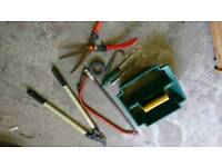 Gardening tools inc lopper and tree saw