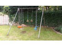 Swing on solid metal frame backyard