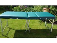 Massage table, very sturdy, adjustable height, comes with case which is on casters.