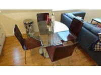 Glass table with 4 chairs