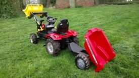 Rolly Toys Massey Ferguson Pedal tractor with operating front loader and tipping trailer.