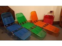 4 colourful sunloungers