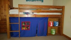 Cabin bed with pull out desk.