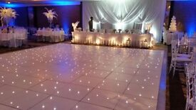 Brand new 20ft by 20ft White/Black starlight dance floor,includes Flight Cases free delivery