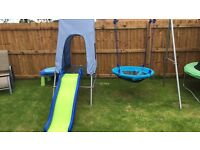 Swing and slide and additional large slide