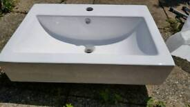 White wall hung sink