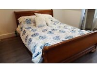 Large double real wood bed with matching chest of drawers