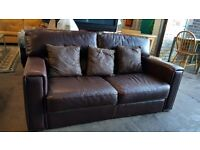 Brown leather 2 seater sofa with scatter cushions