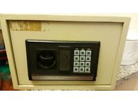 Digital electronic safe. Heavy steel with holes in back and base to secure to floorboards.