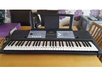 A full size keyboard with ultra wide stereo sound and tuition system