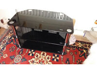 Black Glass TV stand with metal poles 800mm long by 450mm wide (deep)