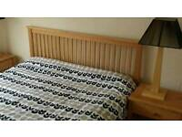 Solid wooden king size bed frame plus 2 matching bedside cabinets for free - £120