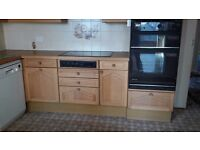 Wood effect country style kitchen cupboards, plus oven and fridge freezer