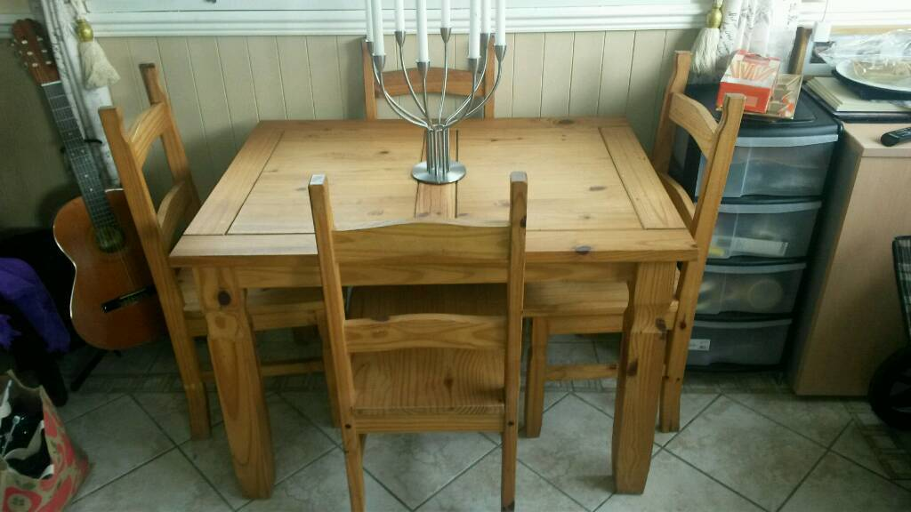 Pine dining table and chairsin East Boldon, Tyne and WearGumtree - Pine dining table with 4 chairs. This is in a honey pine finish. Table and chairs all solid with no wobbles. The table has had a replacement support as can be seen in the photo