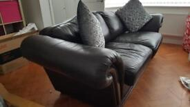 Brown leather 2 seater couch.