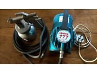 small compressor hose and gun. ideal for spraying varnish or paint
