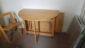 Drop leaf pine table and 4 chairs