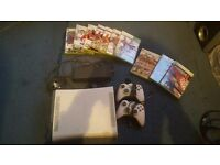 Xbox 360 console with 2 controllers and games
