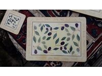Set of 4 place mats, 8 matching coasters and small round table cloth