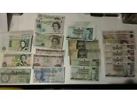 Collection of British banknotes. Coins