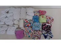 Collection of reusable nappies, inserts and accessories