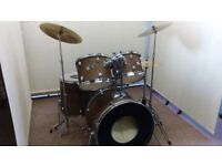 Retired drum teacher has a Premier Olympic drum kit for sale.