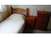 Pine bedroom furniture including Single bed frame, 5 drawer chest/tallboy+3 drawer bedside cabinet.