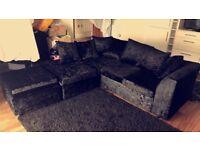 Black crushed velvet corner sofa with foot stall