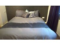 Black leather double bed with two cupboards