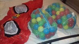 Inflatable car and to bags of balls used once