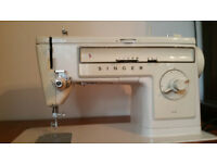 Old Singer sewing machine with storage cabinet/table