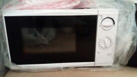 White microwave for sale, good condition used less than a year