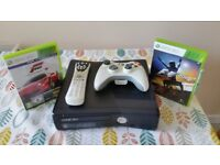 Xbox 360, 3 controllers, DVD remote, Steering wheel + games.
