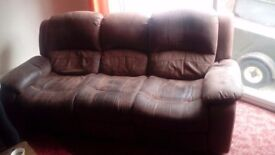 Two brown leather 3 seater reclining sofas