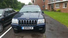 Jeep Grand Cherekee petrol and lpg cheap to run (2002)