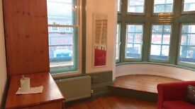 Lovely flat with character by Russell Square station. Large walk - in bay window /high ceilings.