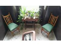 A pair of antique arts and crafts chairs
