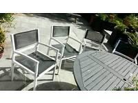 4 white garden chairs