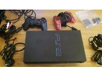 PS2 console with 2 controllers and assorted PS2 and PS1 games