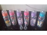 x6 brand new tall nuby bottles and 2 extra teats