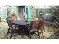 Large garden table and 6 chairs with large parasol