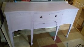 Lavender dresser with two cupboards and two drawers.
