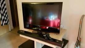"""LG 32"""" HD television and LG soundbar"""