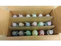 Box of used glitter glues for children's crafts