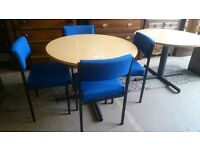 Circular desk with 4 cushioned chairs