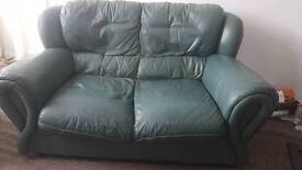 Green leather 2 seater sofa