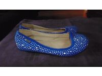Girls flat Xti kids shoes. Bright blue with silver studs Size 1 Worn but good condition